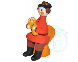 Парень на кресле с лялькой Дымка